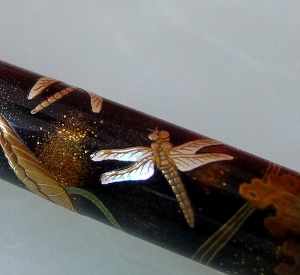 Brilliant mother of pearl inlaid at the wings of the dragonfly.